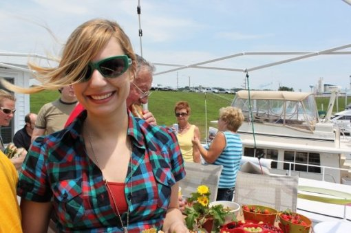 Priscilla standing on Jason's parent's house boat